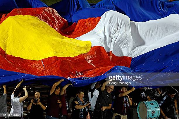 Rapids fans unfurl the Colorado state flag as they celebrate a goal by Jaime Castrillon of the Colorado Rapids celebrates in the 86th minute against...