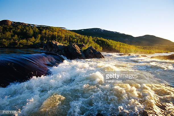 rapids in a mountain landscape. - rapid stock pictures, royalty-free photos & images