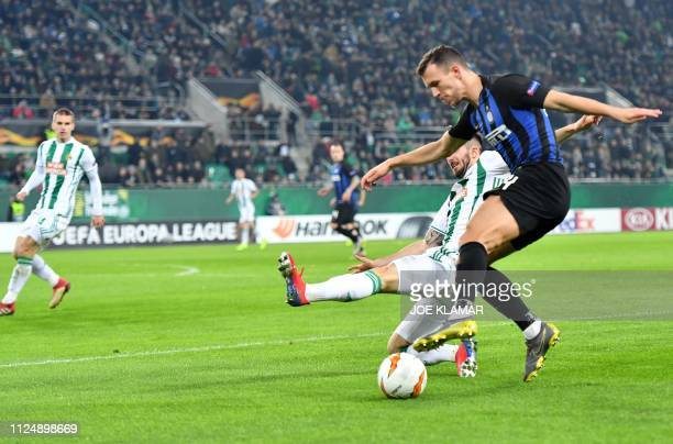 Rapid's Marvin Potzmann and Inter's Ivan Perisic vie for the ball during the UEFA Europa League round of 32 firstleg football match between Rapid...