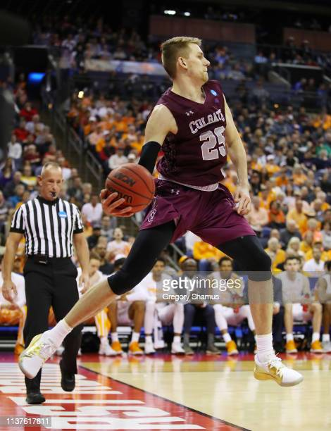Rapolas Ivanauskas of the Colgate Raiders attempts to prevent the ball from going out of bounds during the first half against the Tennessee...