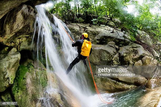 Rappeling down the waterfall