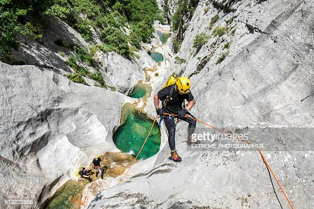 Rappeling in the canyon with water pools
