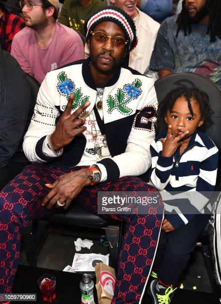 Rapper 2 Chainz and his son Halo Epps attend The Detroit Pistons vs Atlanta Hawks Game at State Farm Arena on November 9 2018 in Atlanta Georgia
