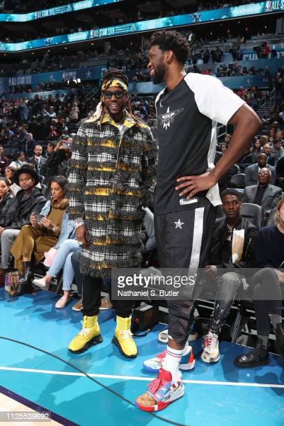 Rapper 2 Chainz and Joel Embiid of Team Giannis talk during the 2019 NBA AllStar Game on February 17 2019 at the Spectrum Center in Charlotte North...