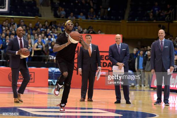Rapper 2 Chainz attempts a halfcourt shot during ESPN's College GameDay show ahead of the game between the North Carolina Tar Heels and the Duke Blue...