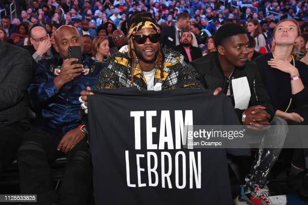 Rapper 2 Chainz holds up a shirt cheering for Team LeBron during the 2019 NBA AllStar Game on February 17 2019 at Spectrum Center in Charlotte North...