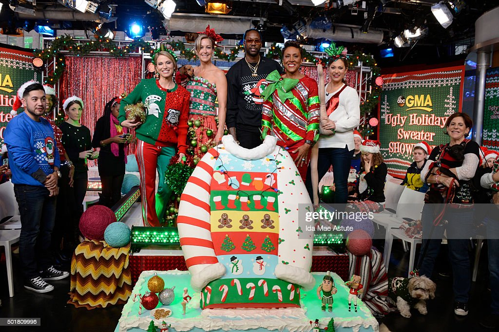 AMERICA - Rapper 2 Chainz hosts the annual GMA Ugly Sweater Contest, on GOOD MORNING AMERICA, 12/17/15, airing on the ABC Television Network. Robin Roberts models the winning outfit. (Photo by Ida Mae Astute/ABC via Getty Images) AMY