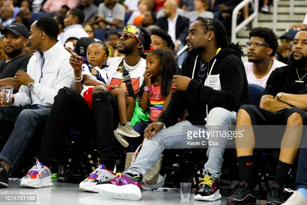 Rapper 2Chainz and Wale look on during week eight of the BIG3 three on three basketball league at Infinite Energy Arena on August 10 2018 in Duluth...