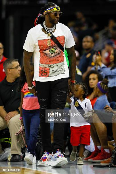 Rapper 2Chainz looks on during week eight of the BIG3 three on three basketball league at Infinite Energy Arena on August 10 2018 in Duluth Georgia