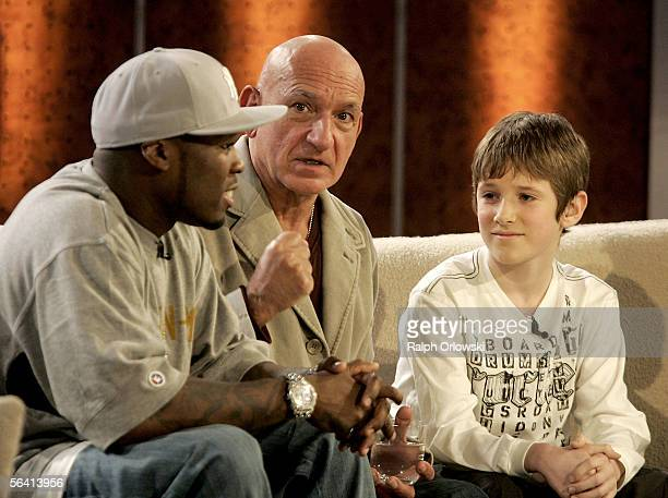 Rapper 50 Cent actor Ben Kingsley and Barney Clark chat during the live broadcast of Wetten dass on ZDF television at the Rheinhalle on December 10...
