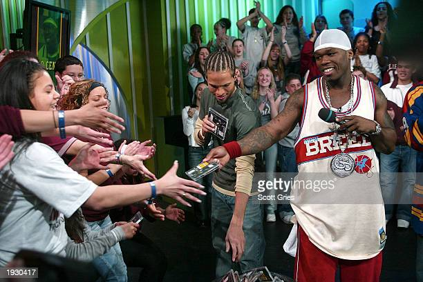 Rapper 50 Cent and VJ Quddus hand out copies of 50's new DVD at the kick off of TRL High School Week on MTV at the MTV Times Square Studios April 14...
