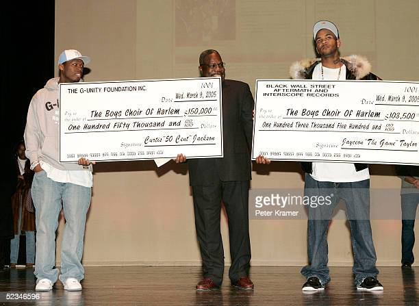 Rapper 50 Cent Dr Walter Turnbull and rapper The Game make an appearance at the Schomburg Center For Research in Black Culture to announce they will...