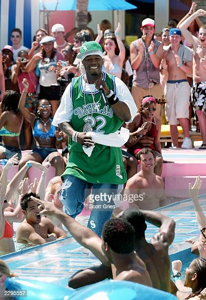 Rapper 50 Cent performs during a taping for MTV Spring Break 2003 at the Surfcomber Hotel March 12 2003 in Miami Beach Florida