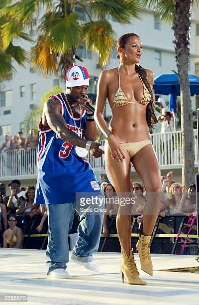 Rapper 50 Cent performs during a taping for 'MTV Spring Break 2003' at the Surfcomber Hotel March 12 2003 in Miami Beach Florida