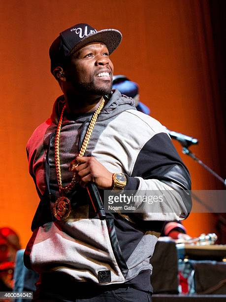 Rapper 50 Cent performs during the 4th Annual 'Home For The Holidays' Benefit Concert at Beacon Theatre on December 6 2014 in New York City