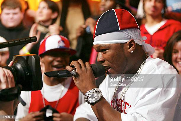 Rapper 50 Cent performs on MTV's 'TRL' at the MTV Times Square Studios February 6 2003 in New York City