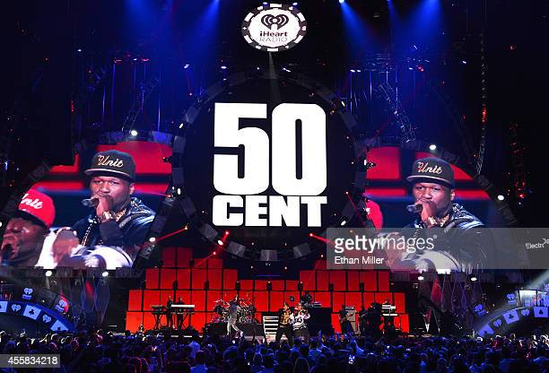 Rapper 50 Cent performs with G-Unit onstage during the 2014 iHeartRadio Music Festival at the MGM Grand Garden Arena on September 20, 2014 in Las...