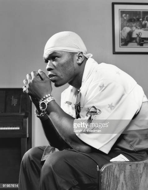 Rapper 50 Cent poses at a portrait session for One World Magazine in 2003