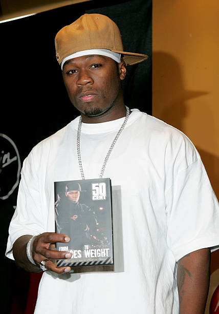 Rapper 50 Cent Poses For Photographers Before Signing Copies Of His New Autobiography From Pieces