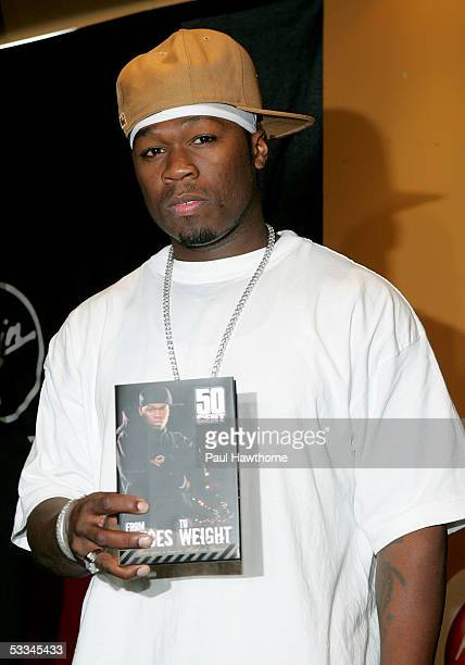 Rapper 50 Cent poses for photographers before signing copies of his new autobiography From Pieces to Weight Once Upon a Time in Southside Queens at...