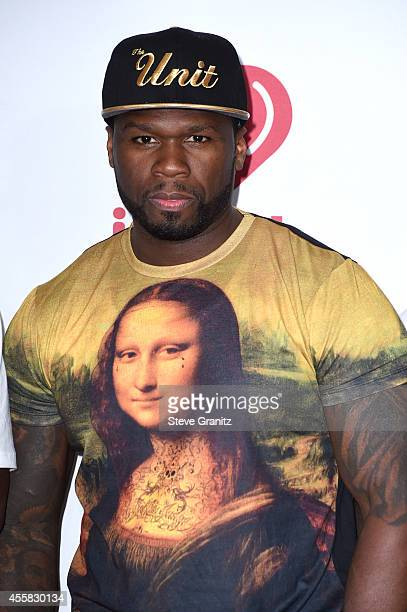 Rapper 50 Cent poses in the press room during the 2014 iHeartRadio Music Festival at MGM Grand Garden Arena on September 20 2014 in Las Vegas Nevada