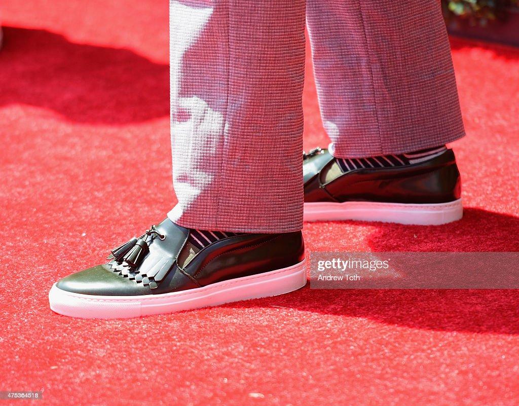 Rapper 50 Cent, shoe detail, attends the 8th Annual Veuve