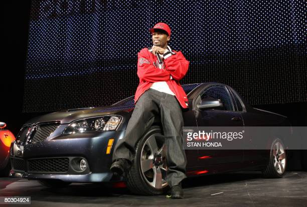 Rapper 50 Cent sits on a 2010 Pontiac G8 Sport Truck after it is unveiled on March 19 2008 at the New York International Auto Show AFP PHOTO/Stan...