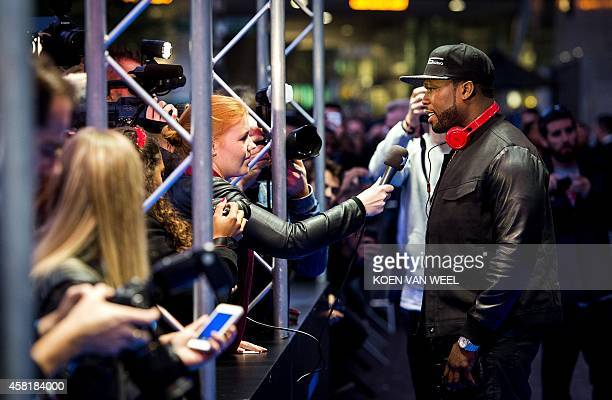 US rapper 50 Cent speaks to a journalist during the release party of his new SMS Audio headphones in the Heineken Music Hall in Amsterdam the...