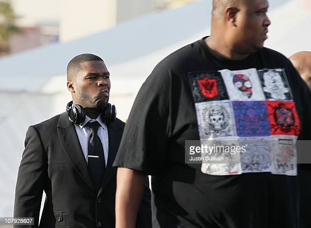 Rapper 50 Cent walks with a bodyguard during the 2011 International Consumer Electronics Show at the Las Vegas Convention Center January 7 2011 in...