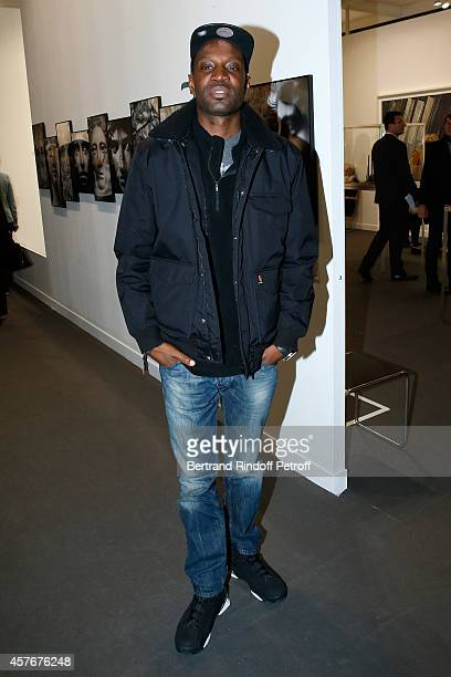 Rapper Abd al Malik attends the FIAC 2014 International Contemporary Art Fair Official Opening at Le Grand Palais on October 22 2014 in Paris France