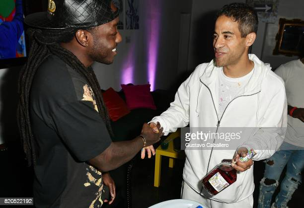 Rapper Ace Hood and Streetartistturnedartworld phenomenon JonOne attend the Hennessy VS Limited Edition by JonOne launch party at Cafeina on July 21...
