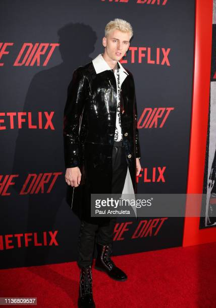 """Rapper / Actor Machine Gun Kelly attends the Premiere Of Netflix's """"The Dirt"""" at ArcLight Hollywood on March 18, 2019 in Hollywood, California."""