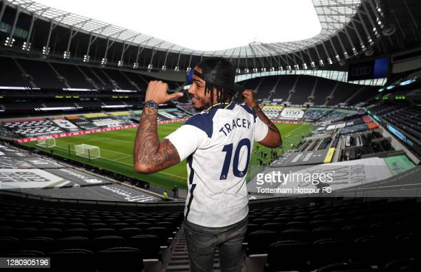 Rapper AJ Tracey poses for a photo inside the stadium prior to the Premier League match between Tottenham Hotspur and West Ham United at Tottenham...