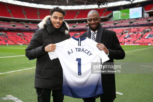 Rapper AJ Tracey poses for a picture with former Tottenham Hotspur player Ledley King prior to the Premier League match between Tottenham Hotspur and...