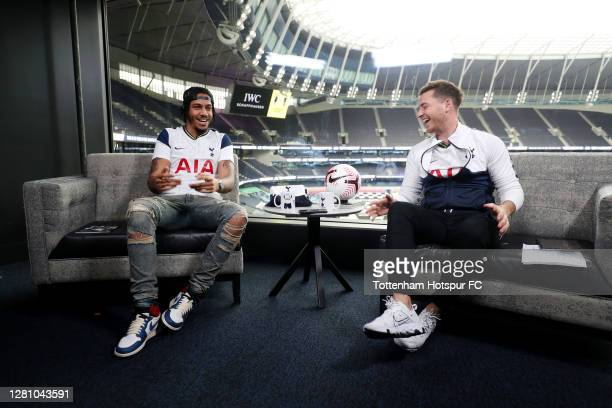 Rapper AJ Tracey with N17 Live presenter Ben Haines during the Premier League match between Tottenham Hotspur and West Ham United at Tottenham...
