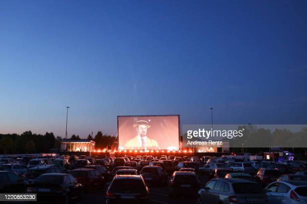 Rapper Alligatoah performs at the Georg Schutz drivein cinema during the coronavirus crisis on April 23 2020 in Dusseldorf Germany Driveins are...