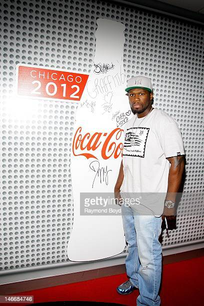Rapper and actor 50 Cent poses for photos in the WGCIFM 'CocaCola Lounge' in Chicago Illinois on JUNE 21 2012