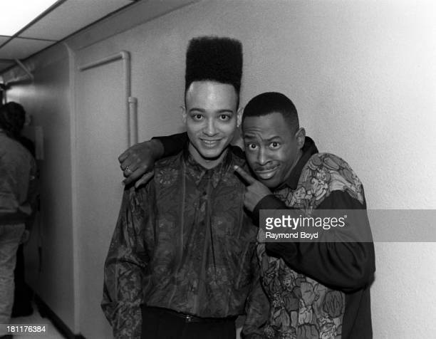 Rapper and actor Christopher Kid Reid of Kid 'n Play and comedian and actor Martin Lawrence poses for photos backstage at the Vic Theater in Chicago...