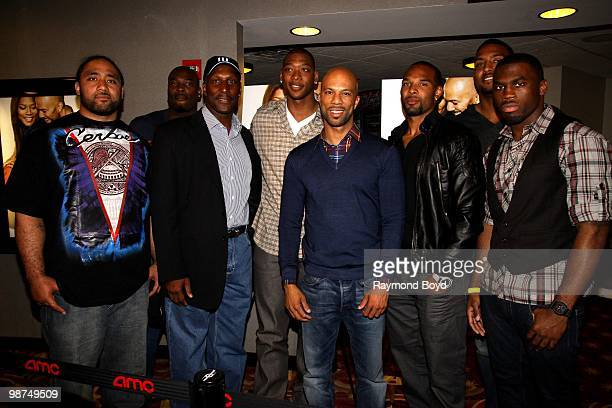 Rapper and actor Common poses for photos with Chicago Bears football players Matt Toeaina Israel Idonije Otis Wilson basketball player and costar...