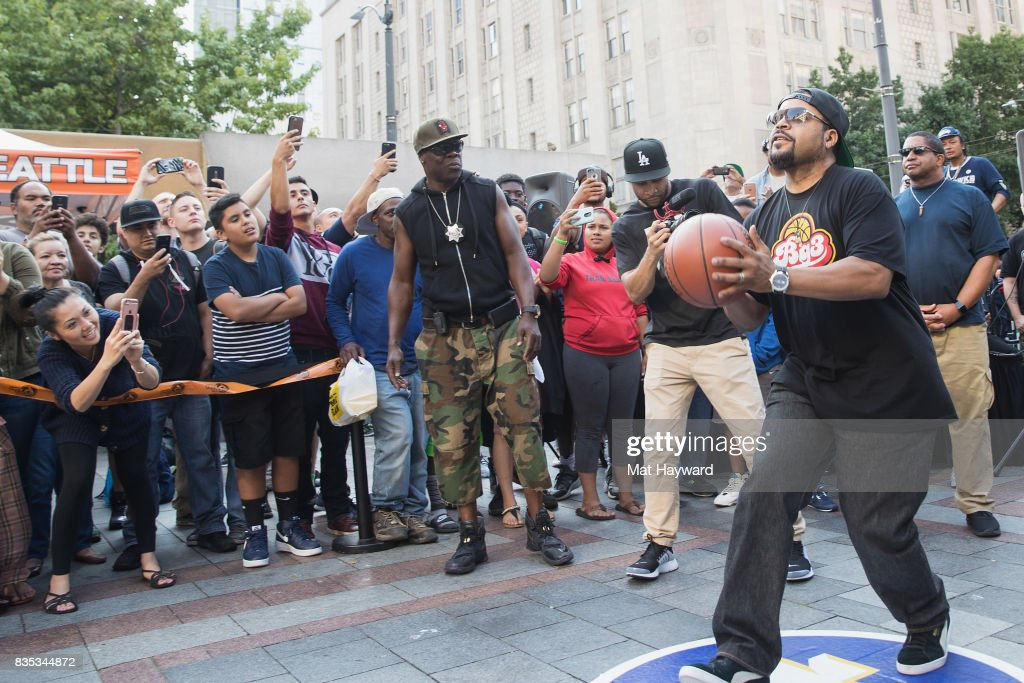Rapper and actor Ice Cube attempts a 4 point shot during a promotion for BIG3 professional 3 on 3 basketball at Westlake Center on August 18, 2017 in Seattle, Washington.