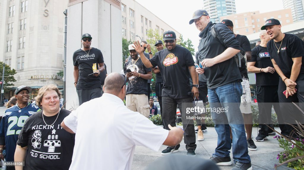 Rapper and actor Ice Cube greets a fan during a promotion for BIG3 professional 3 on 3 basketball at Westlake Center on August 18, 2017 in Seattle, Washington.
