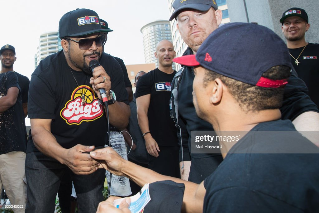 Rapper and actor Ice Cube shakes hands with a fan after giving away tickets during a promotion for BIG3 professional 3 on 3 basketball at Westlake Center on August 18, 2017 in Seattle, Washington.