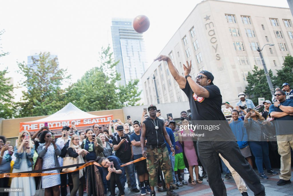 Rapper and actor Ice Cube shoots and makes a 4 point shot during a promotion for BIG3 professional 3 on 3 basketball at Westlake Center on August 18, 2017 in Seattle, Washington.