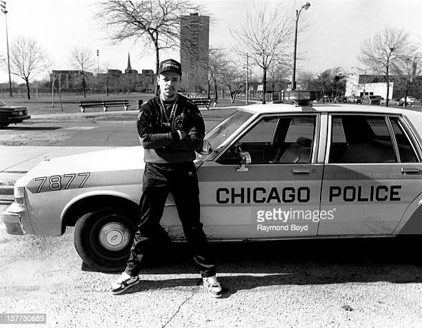 Rapper and actor Ice-T poses next to a Chicago Police car during a visit to Dunbar High School in Chicago, Illinois in 1990.