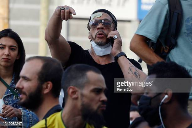Rapper and actor Joey Starr takes part in a demonstration after French medical experts exonerated the gendarme involved in the arrest of Adama Traore...