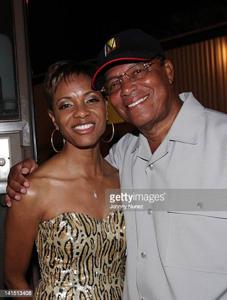 Rapper and actress MC Lyte and Minister Louis Farrakhan attend Jazz In The Gardens at Sunlife Stadium on March 17 2012 in Miami Florida