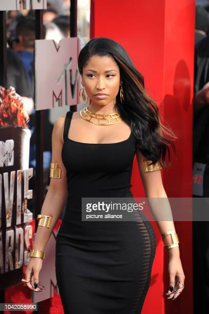 Rapper and RB singer Nicki Minaj arrives at the 2014 MTV Movie Awards at Nokia Theatre LA Live in Los Angeles USA 13 April 2014 Photo Hubert...