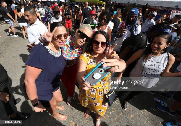 Rapper and reality TV personality Veronica Vega of 'Love Hip Hop Miami' poses for selfies with Valerie Cruz and Julia Puente of Chicago during the...