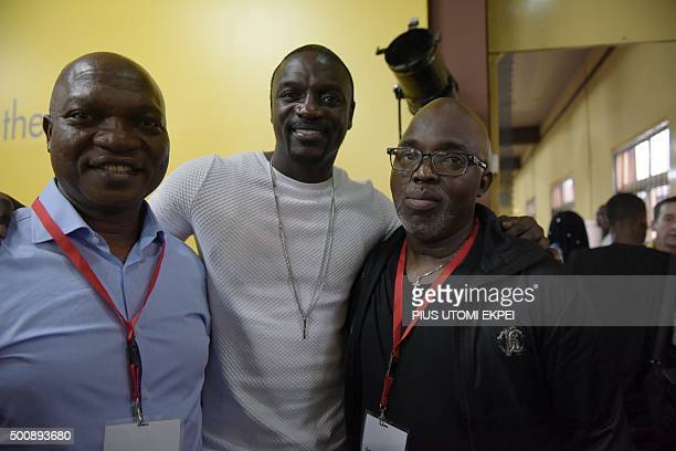 Rapper and songwriter Akon poses with Chairman and Managing director of Shell in Nigeria Osagie Okunbor and Nigerian Football Federation President...