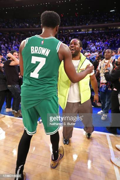 Rapper, ASAP Ferg talks with Jaylen Brown of the Boston Celtics after the game against the New York Knicks on October 20, 2021 at Madison Square...